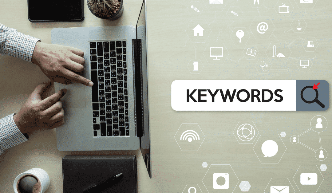 man at computer with keywords graphic in search bar