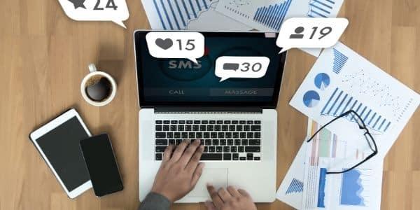 man on computer creating social media post